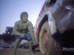 The Incredible Hulk turning over a car.